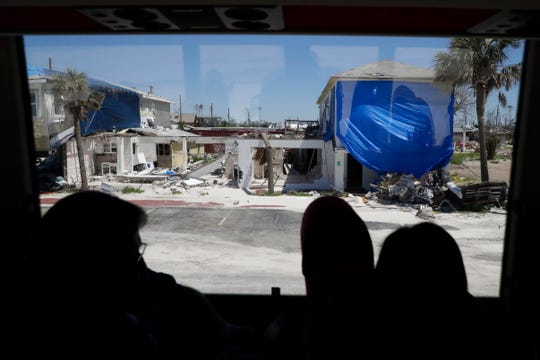 Hurricane Michael Recovery Mission participants peer out the bus window at the damage in Mexico Beach, Fla. Tuesday, April 16, 2019. The two-day tour showed the them firsthand the damage and destruction that remains six months after Hurricane Michael struck the Panhandle.