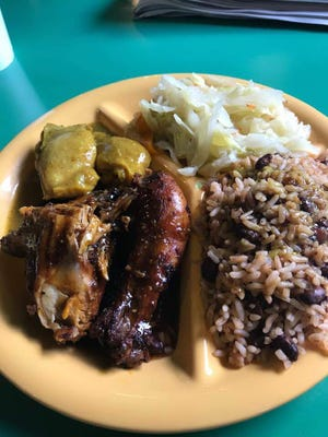 Curry and jerk chicken, cabbage and rice and beans from G&G Caribbean Restaurant's new Apalachee Parkway location.