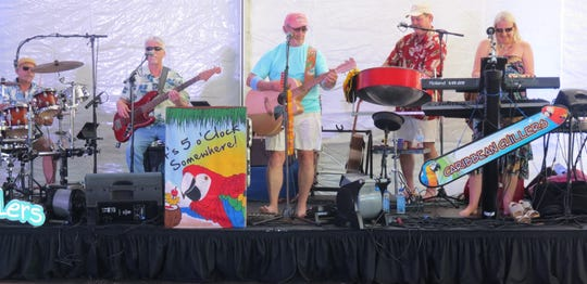 The Caribbean Chillers bring the Jimmy Buffet sound to the ribbon cutting ceremony for phase one of the $32 million Believe Capital Campaign.