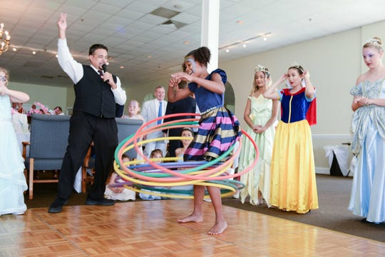 "Kali Daniels was the winner of the hula-hoop showdown at ""Butterfly Kisses,"" the father/daughter dance hosted by Grace Way Village at Pelican Yacht Club in Fort Pierce."