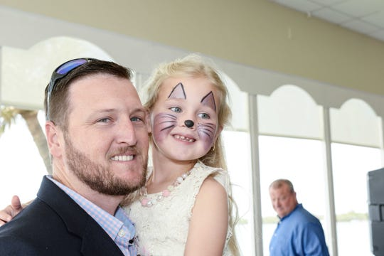 Joe and Hannah Watkins attend the father/daughter dance hosted by Grace Way Village at Pelican Yacht Club in Fort Pierce.