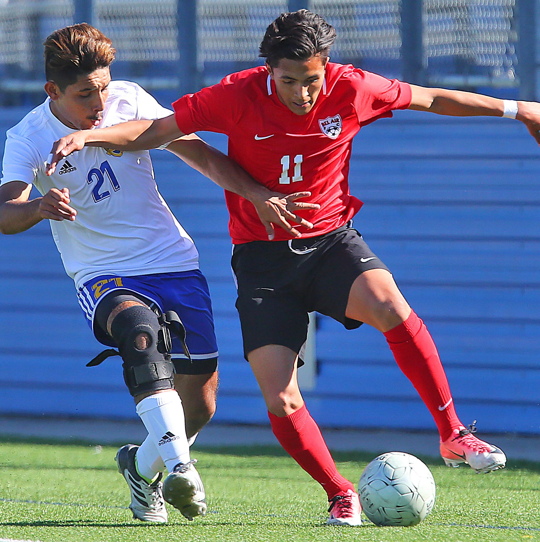 Valley View's Cuhutemoc Gonzalez (2) and El Paso Bel Air's Bryan Guzman (11) battle for the ball during a UIL Class 5A Semifinal game at Birkelbach Field on Thursday, April 18, 2019, in Georgetown. (Joel Martinez | jmartinez@themonitor.com)