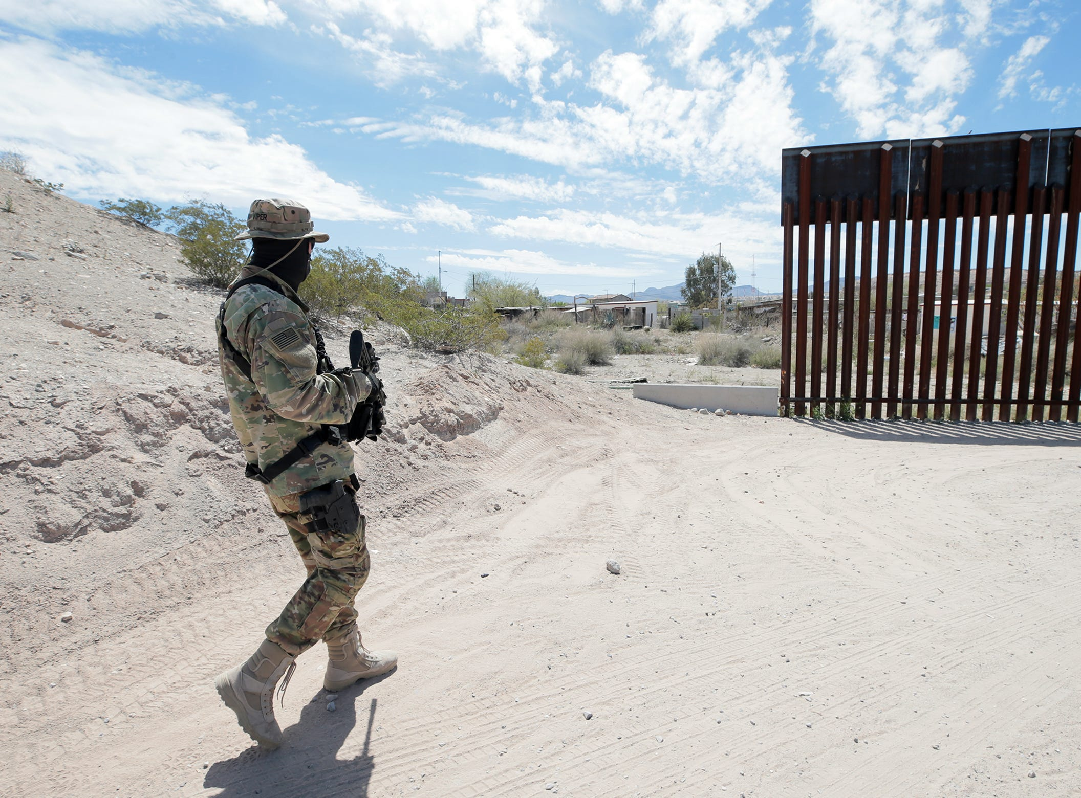 """Stinger,"" A member of the United Constitutional Patriots-New Mexico Border Ops, leaves camp in Anapra, New Mexico en route to patrol the border."