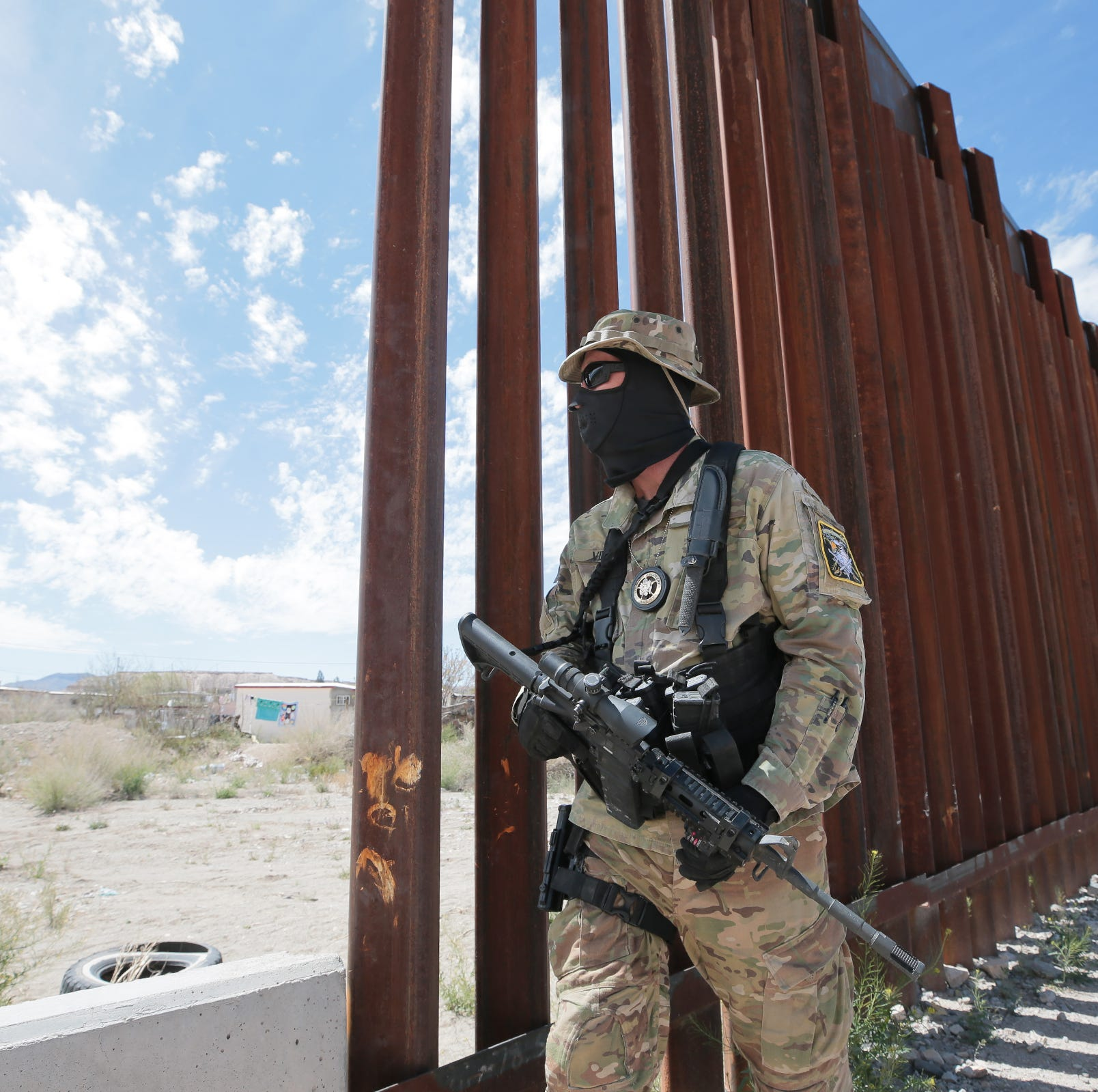 Armed civilians are detaining migrants at the border. The ACLU wants them investigated.