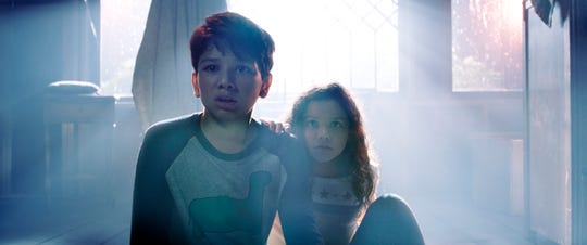 "This image released by Warner Bros. Pictures shows Roman Christou, left, and Jaynee-Lynne Kinchen in a scene from ""The Curse of La Llorona."""