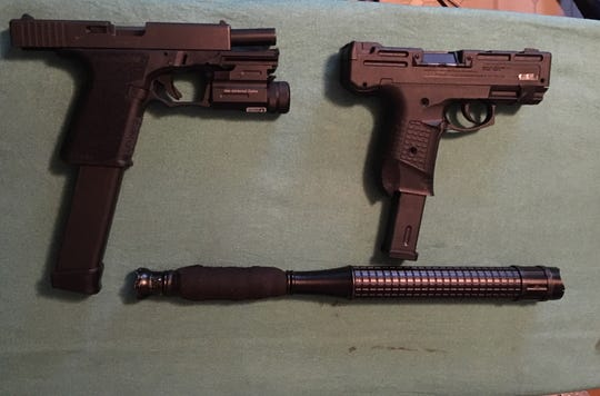 Firearms seized by authorities during a probation search in Oxnard on Saturday.