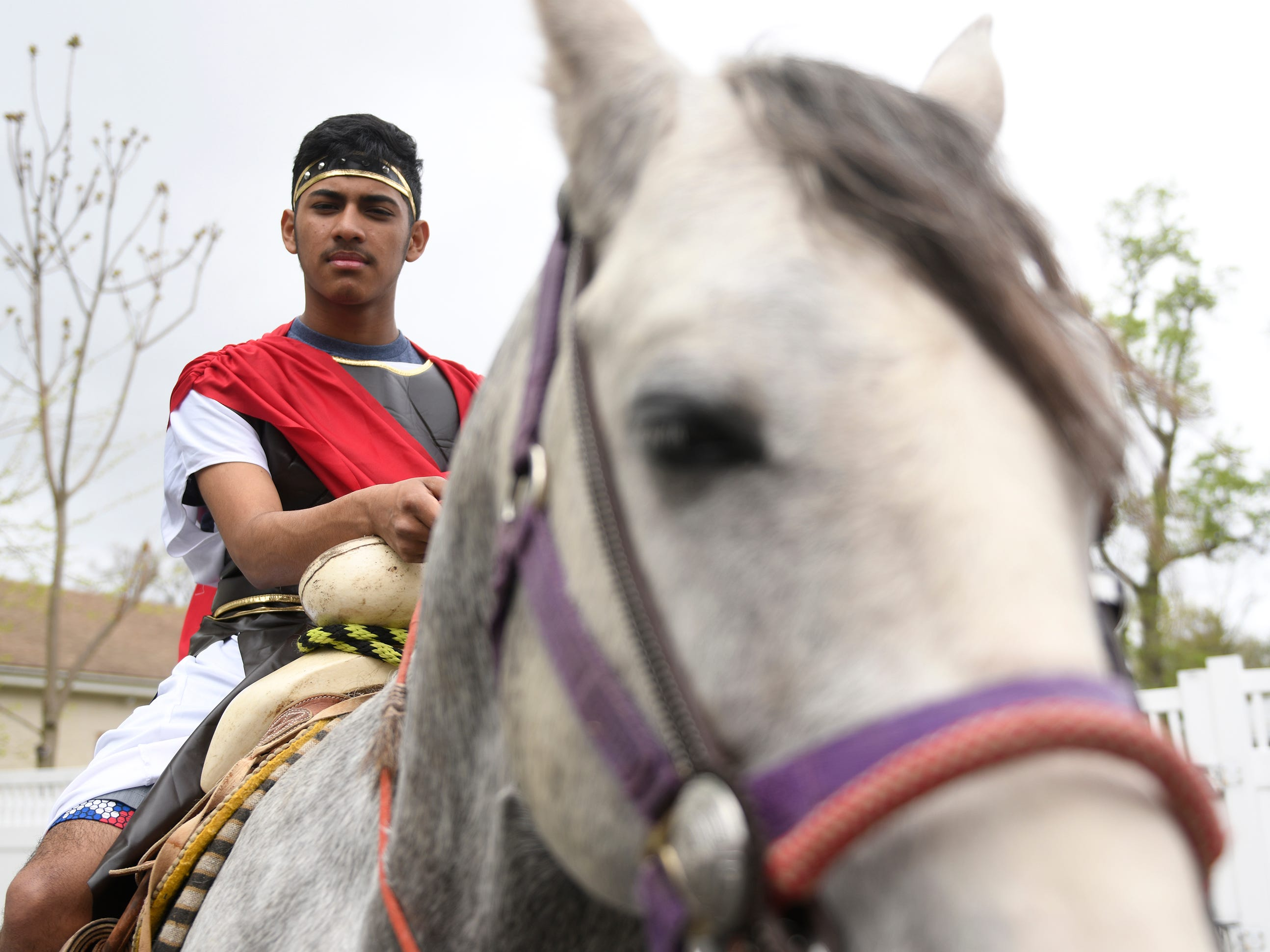 Lovenzo Garcia rides a horse during the Good Friday procession, hosted by Divine Mercy Parish in Vineland. The performance of the Passion of Christ marched down Almond Street.