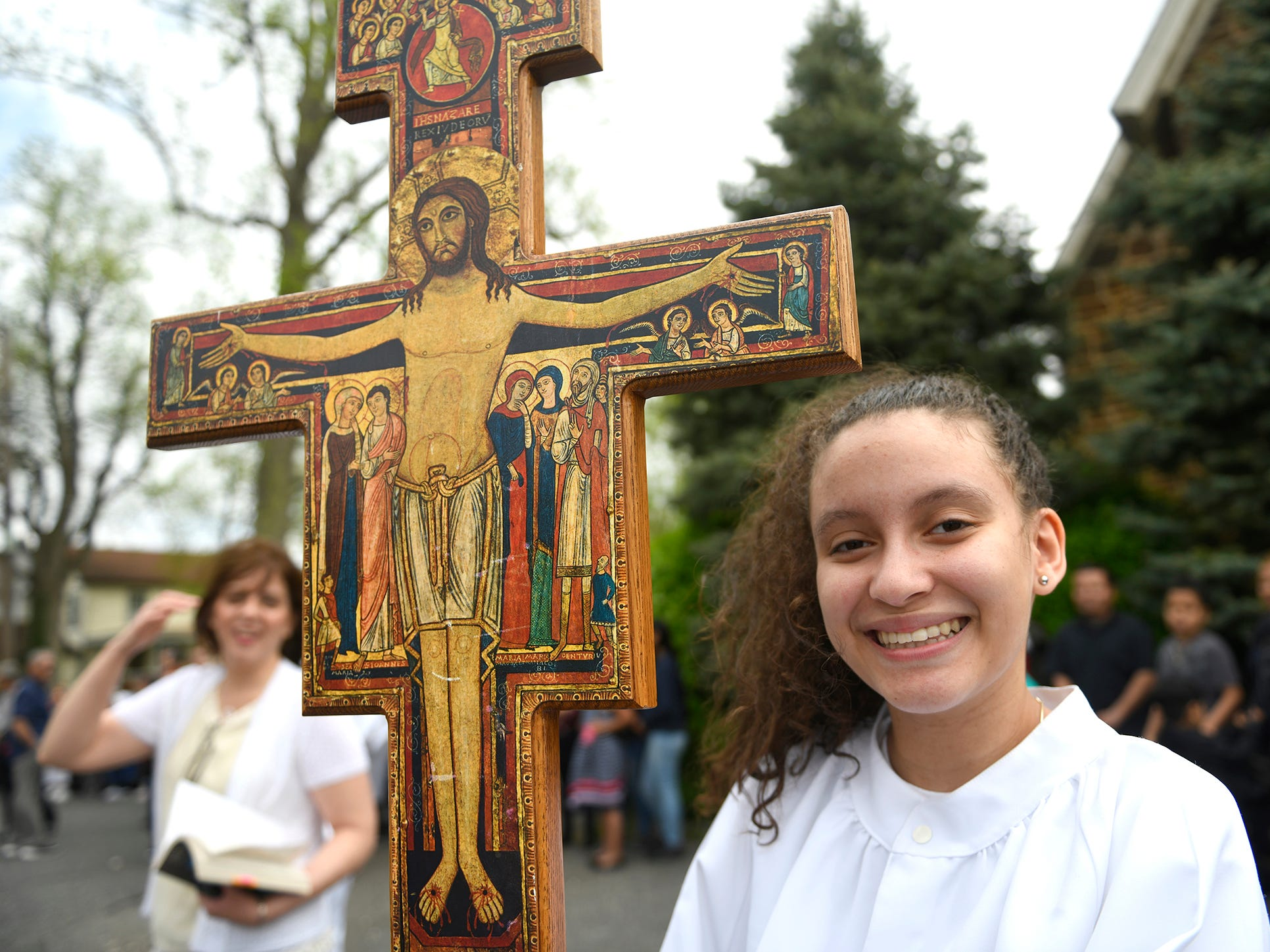 Betzalis DeLaCruz participated in leading the Good Friday procession down Almond Street on Friday, April 19.