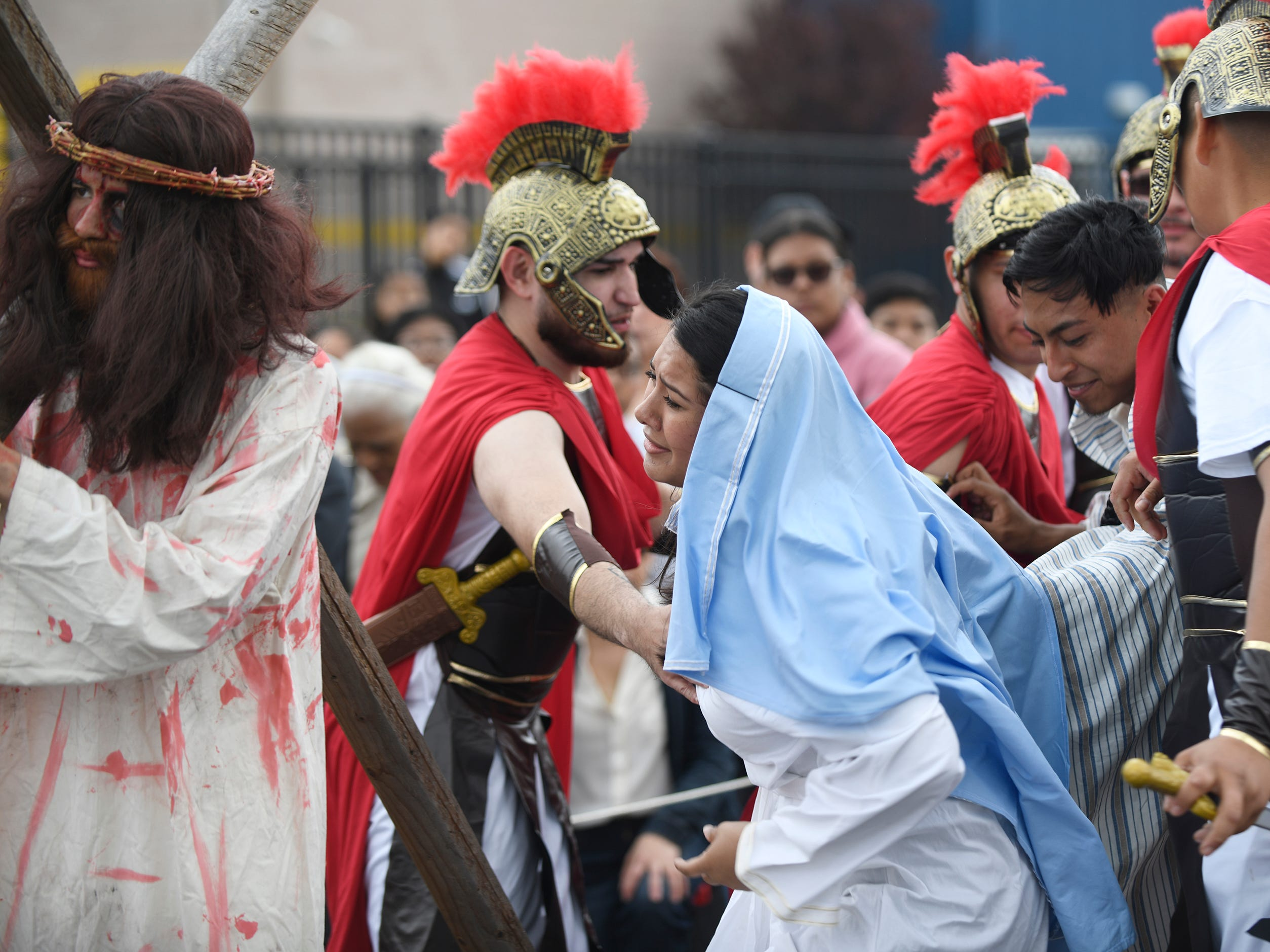 Mary, played by Elizabeth Espinosa, moves towards Jesus, played by Darvin Diaz during the Good Friday procession, hosted by Divine Mercy Parish in Vineland. The performance of the Passion of Christ marched down Almond Street.