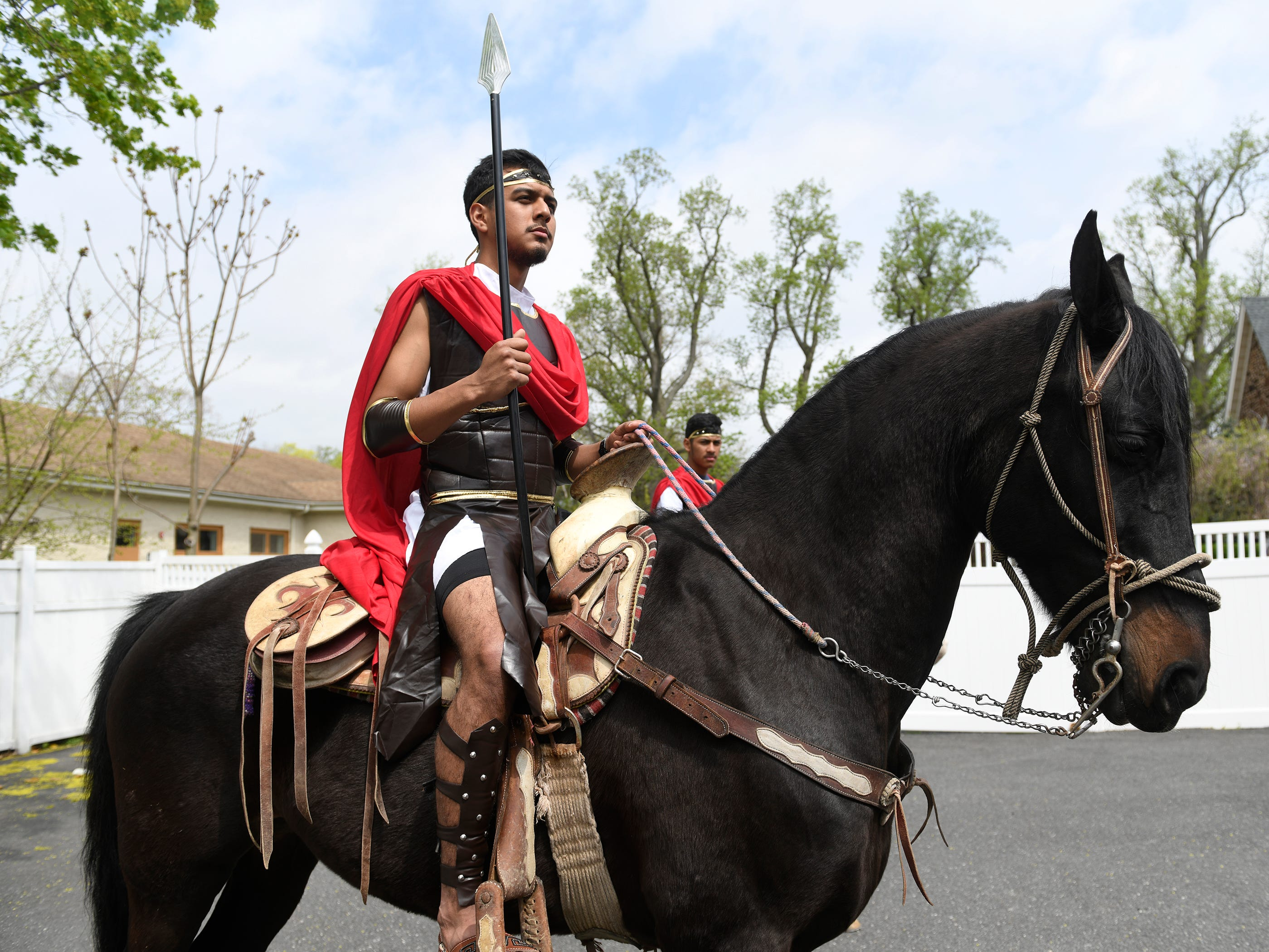 Tony Martinez rides a horse during the Good Friday procession, hosted by Divine Mercy Parish in Vineland. The performance of the Passion of Christ marched down Almond Street.