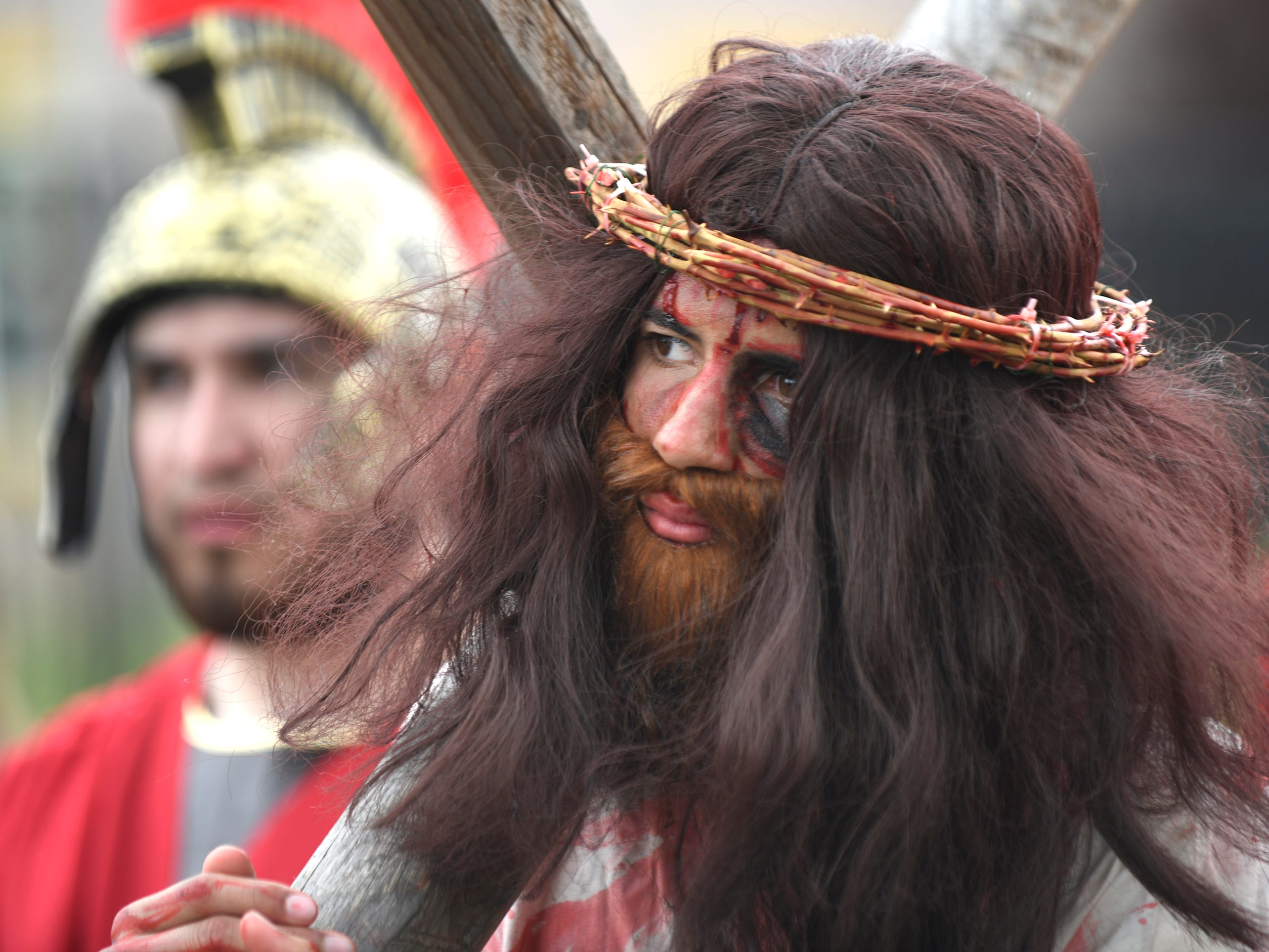 Jesus, played by Darvin Diaz, walks down Almond Street in Vineland during the Good Friday procession, hosted by Divine Mercy Parish.