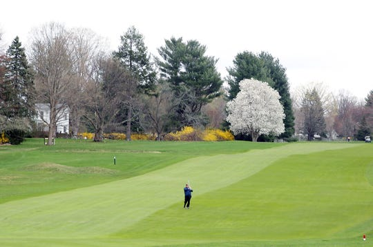 A golfer hits out of a fairway at Waccabuc Country Club in South Salem April 19,  2019. There is proposed legislation that could significantly raise the taxes of golf and country clubs in New York State.