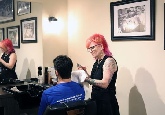 Danielle Braun works on a customer at The Fine Men's Salon of Westchester in Mamaroneck April 18,  2019.