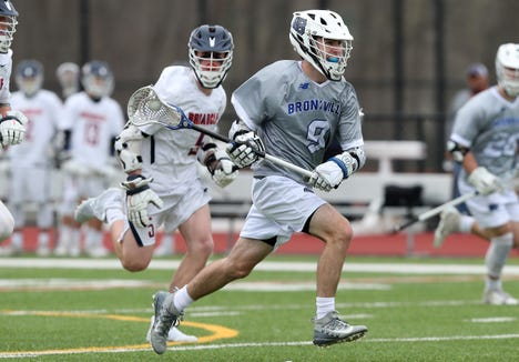 Bronxville's Tim Murray (9) drives to the goal against Briarcliff during boys lacrosse action at Briarcliff High School  April 18,  2019. Bronxville won the game 8-7.