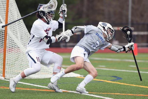 From right, Bronxville's Nate Davis (3) tries to get around Briarcliff's Andrew Kanovsky (16) during boys lacrosse action at Briarcliff High School  April 18,  2019. Bronxville won the game 8-7.