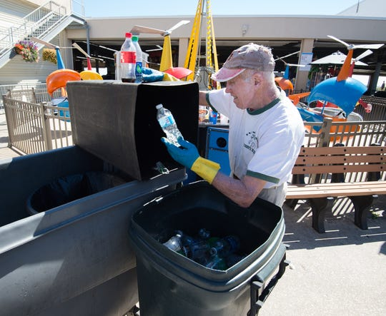 Al Fasnacht, co-founder of Funland in Rehoboth Beach, separates plastic bottles and aluminum cans for recycling in 2016.