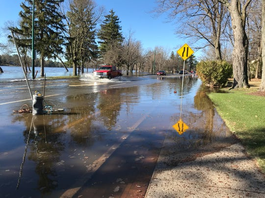 A truck goes through standing water on State 54 in Wisconsin Rapids Friday morning. The city has closed the highway to traffic but is allowing some vehicles to travel north through the flooded road.