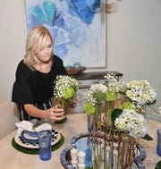 Polka-Dot Penguin's, design assistant, Emily Shaver helps decorate one-of-thirteen rooms that will be featured in this year's annual Decorator Show House, located at 2014 Clarinda Ave. Tickets sold for the event benefit the Faith Refuge for Women and Children.