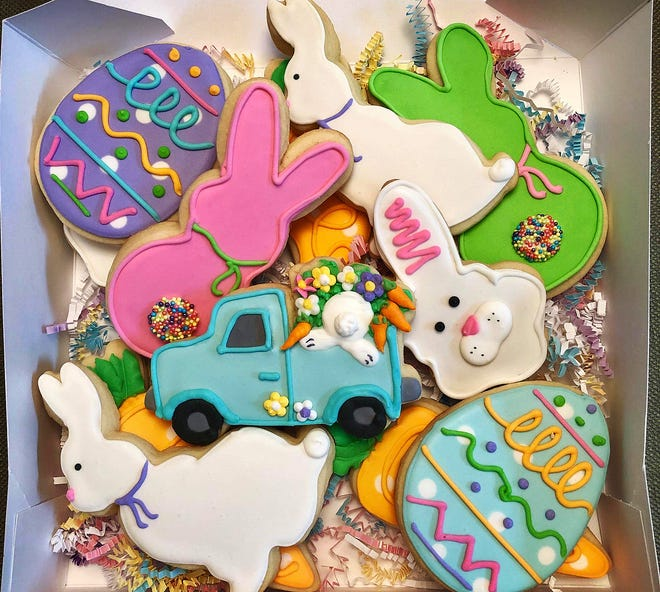 A selection of colorful Easter cookies boxed up and ready at Cakey Bakey Art.