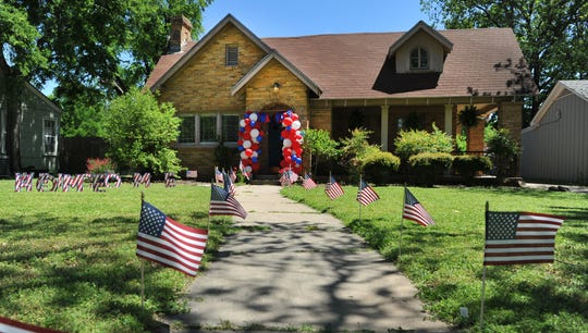 Welcome home signs and banners decorated homes along Milby Avenue to help celebrate the safe return of Major Andy Morton, Friday afternoon.