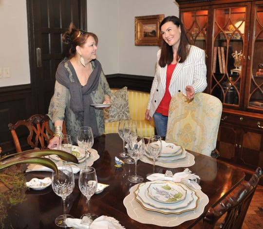 Cindy King, left, and Allison Gray decorate the main dining room for the 9th annual Decorator Show House, located at 2014 Clarinda Ave. Tickets sold for the event benefit the Faith Refuge for Women and Children.