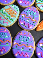 Hand-decorated Easter egg-shaped cookies by Sam Beauchamp of Cakey Bakey Art.