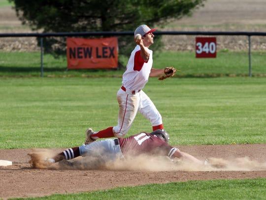 Chase Karling, of John Glenn, slides into second base while Sheridan's Reece Trowbridge throws to first base.