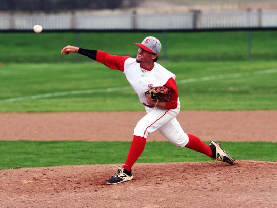 Drew Campbell, of Sheridan, fires a pitch against John Glenn. Campbell is committed to play baseball for Marietta next year.