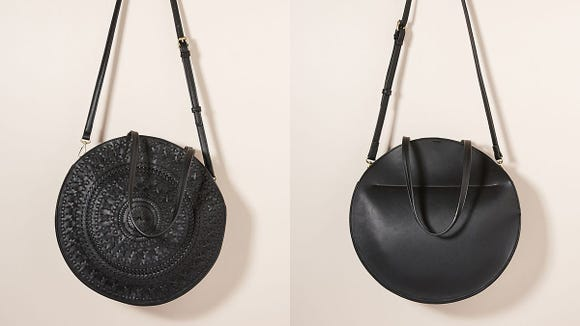 This classic circle bag features a woven front for added texture and definition.