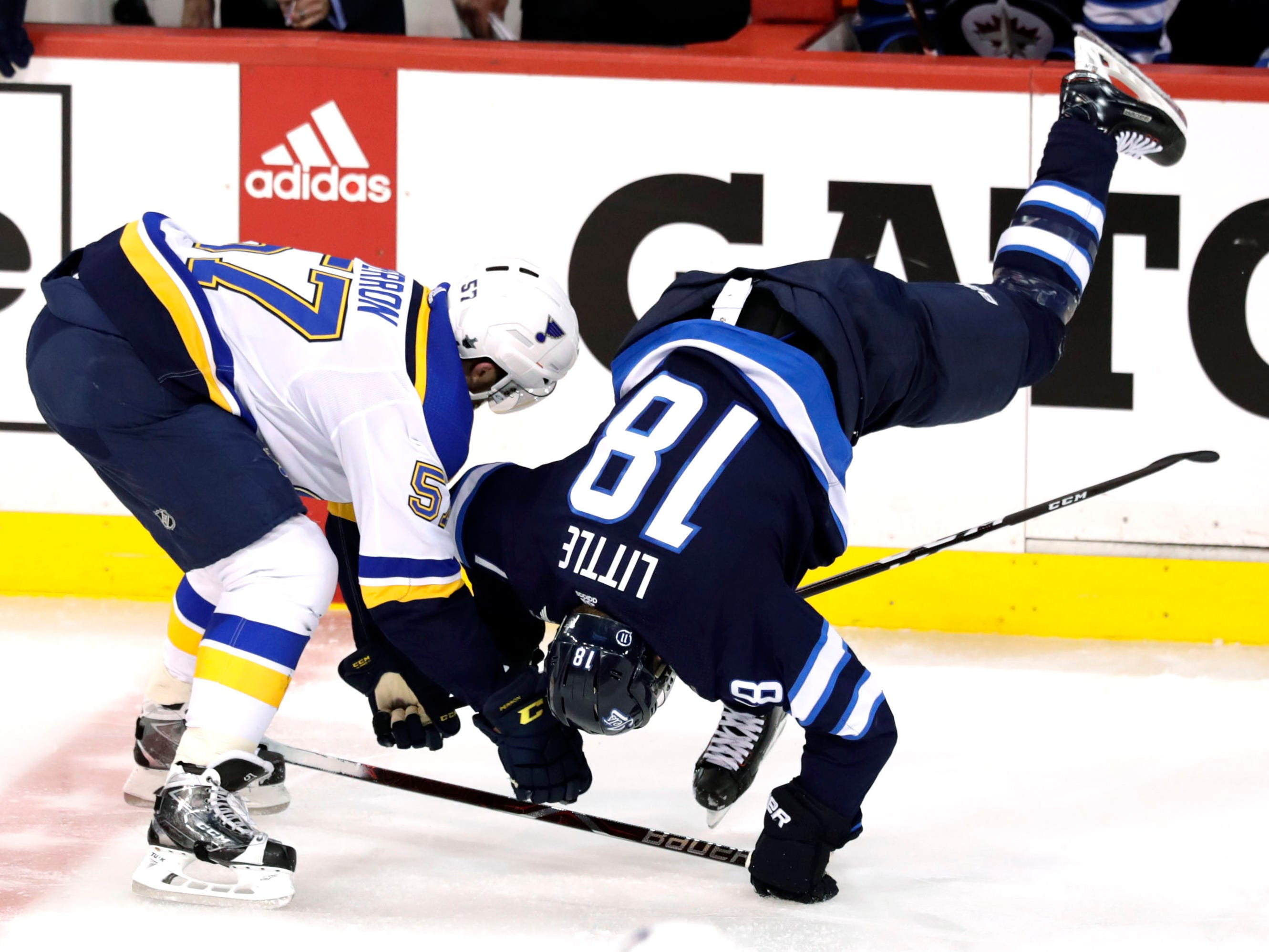 First round: Blues left wing David Perron upends Jets center Bryan Little in the second period of Game 5.