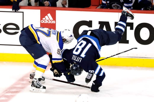 First round: Blues left wing David Perron upends Jets center Bryan Little in the second period of Game 5. James Carey Lauder,USA TODAY Sports