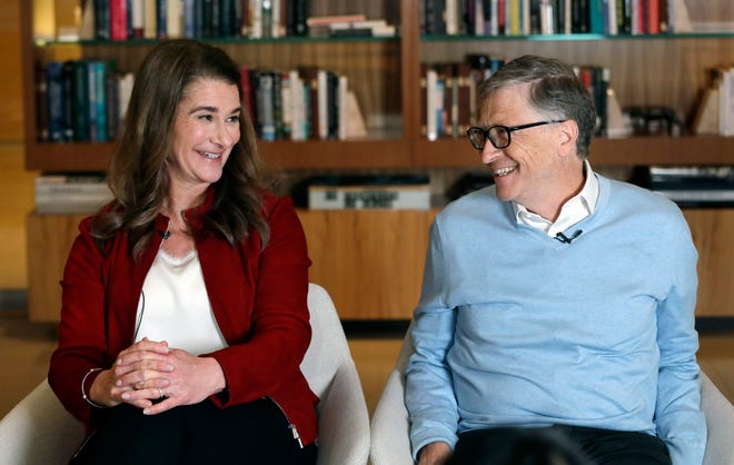 Bill and Melinda Gates look toward each other and smile while being interviewed in January.
