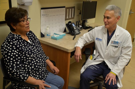 At Torrance Memorial Medical Center, Dr. Karl Fukunaga meets with a patient, Margarita Marrou, a retired medical clerk originally from Peru. She was diagnosed several years ago with a severe form of fatty liver disease and has cut down her sugar consumption and lost weight.