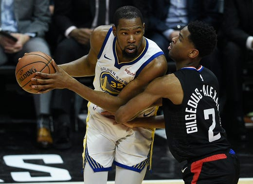 April 18: Warriors forward Kevin Durant  (35) tries to work around Clippers defender Shai Gilgeous-Alexander (2) during Game 3 in Los Angeles.