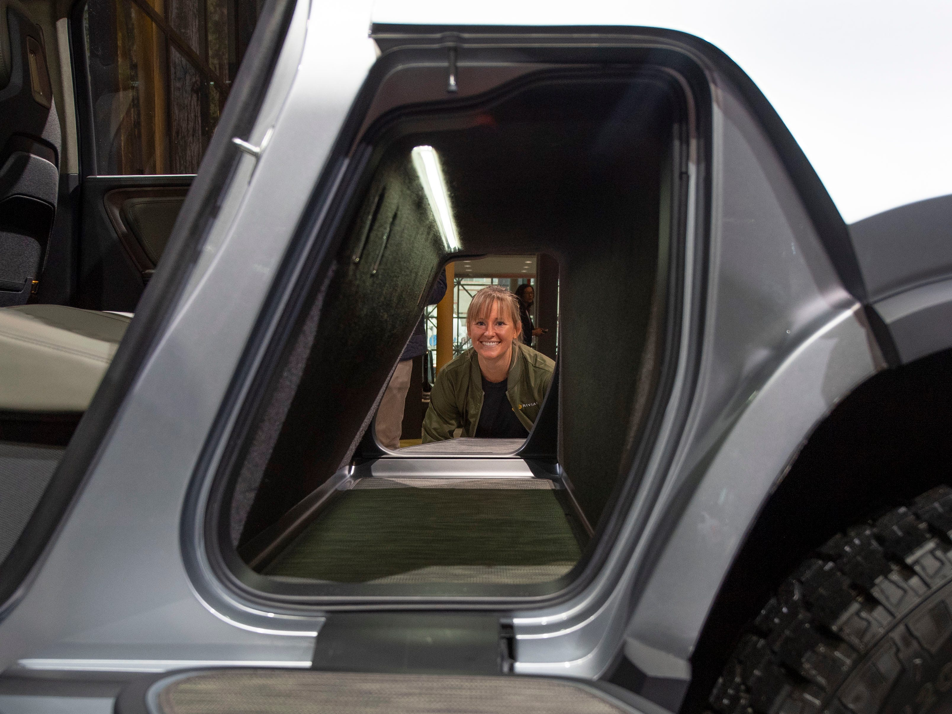 The Rivian RT1 electric truck has storage, known as a gear tunnel, where a drive train used to be.