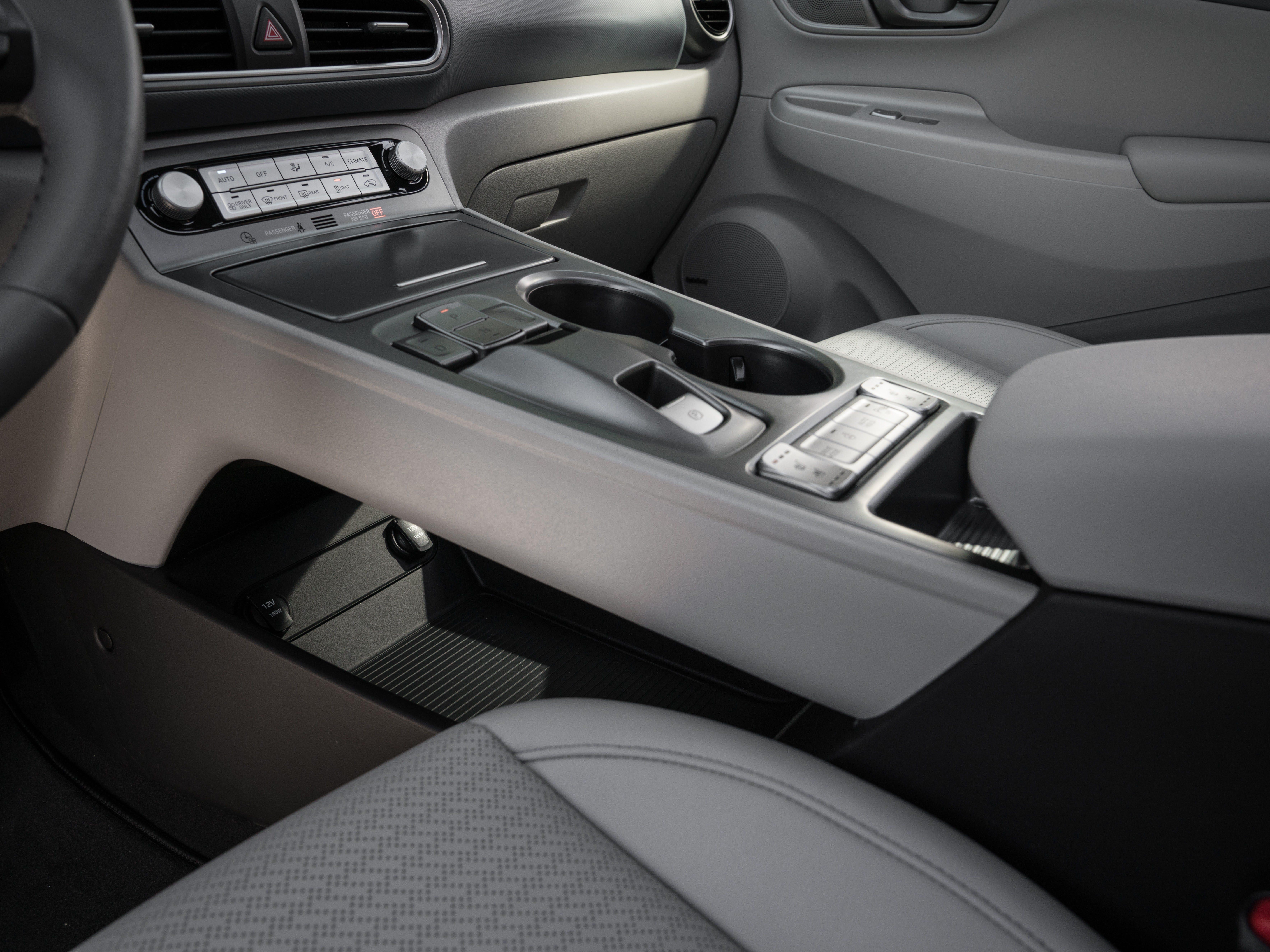 The Hyundai Kona electric car comes with storage space under a center console bridge.