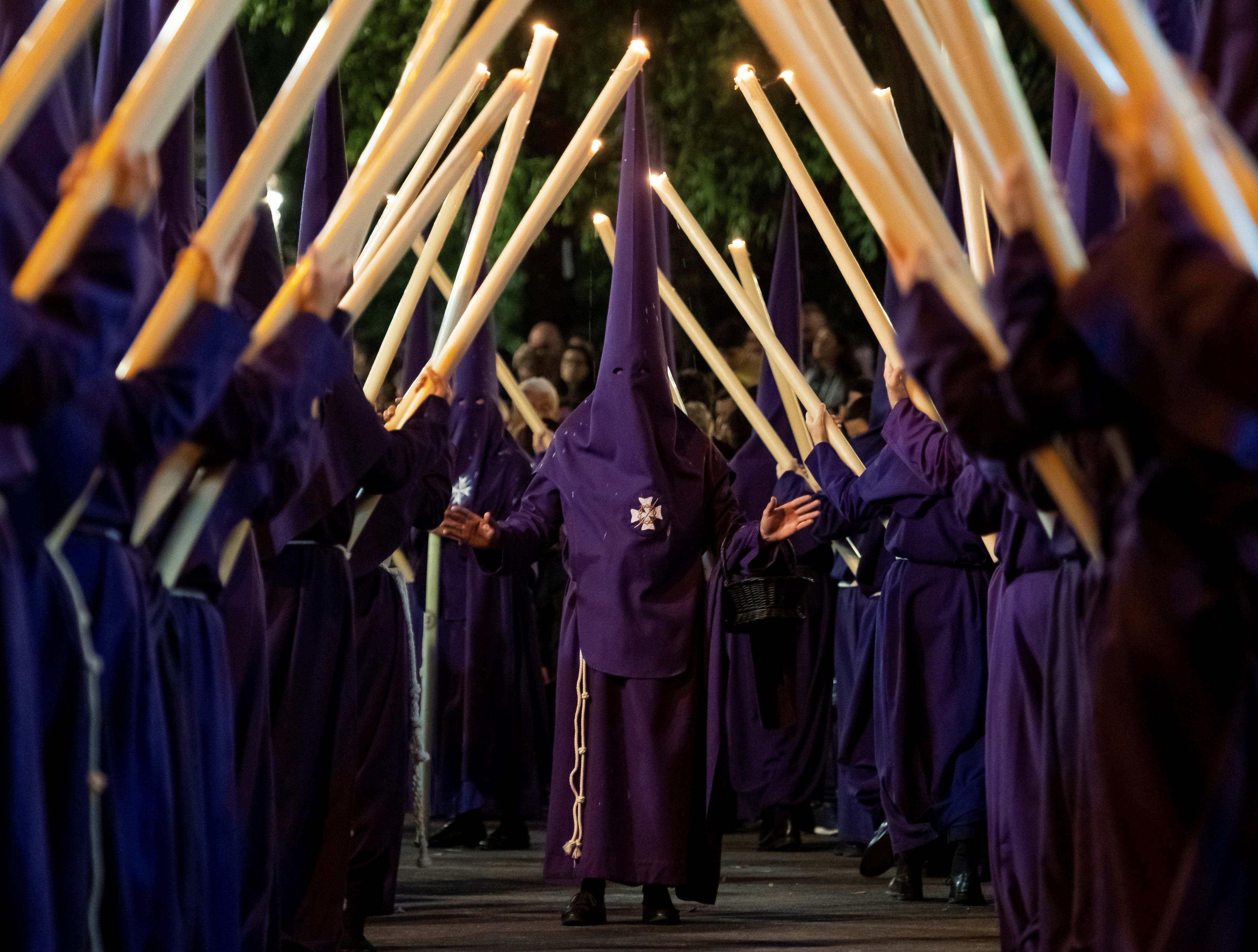 'Nazarenos' take part ing the 'The Valey' religious procession on Maundy Thursday duringof the Holy Week celebrations in Seville, Andalusia, Spain on April 18, 2019.