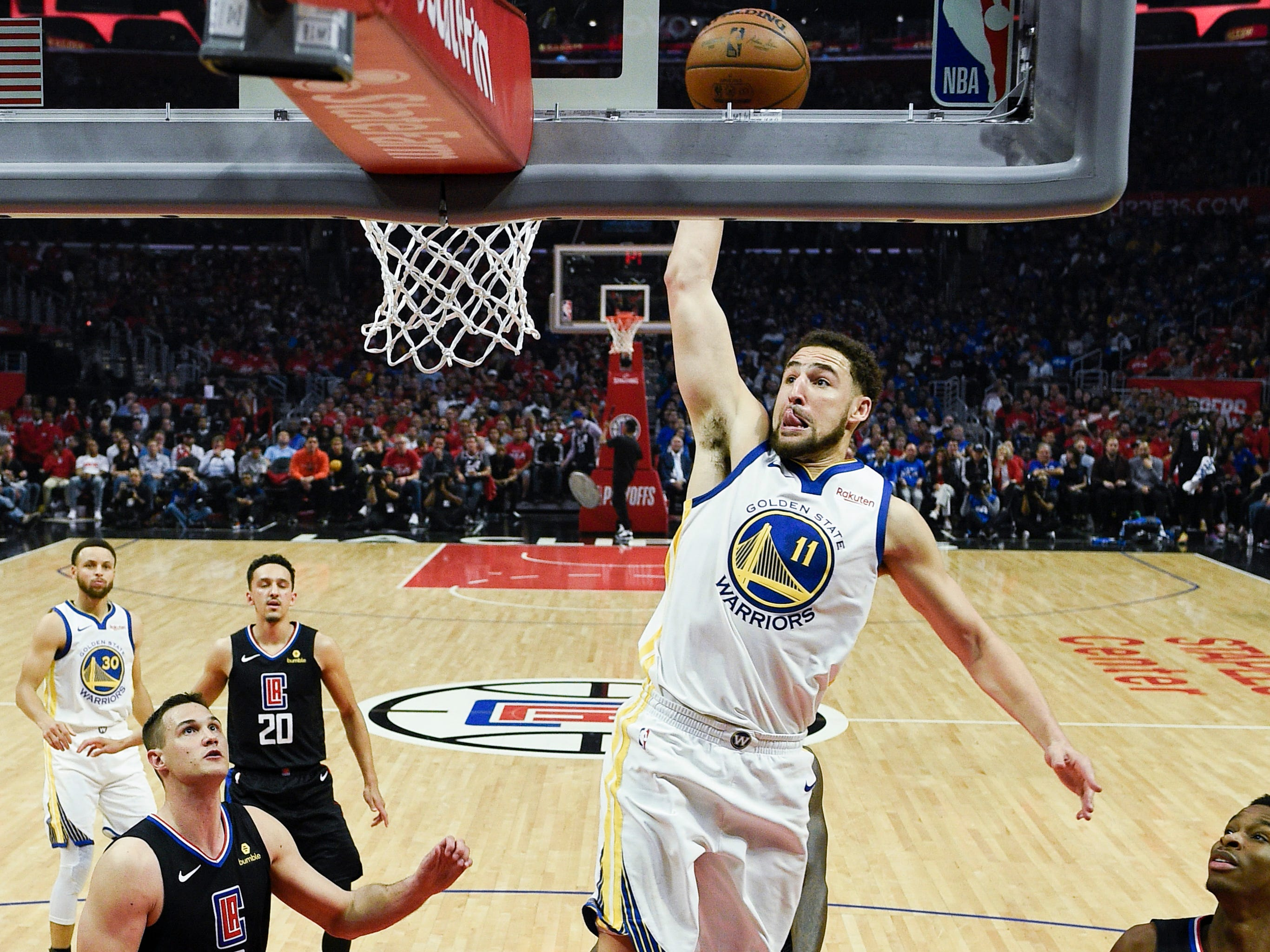 April 18: Warriors guard Klay Thompson soars to the bucket for a one-handed slam during Game 4 against the Clippers.