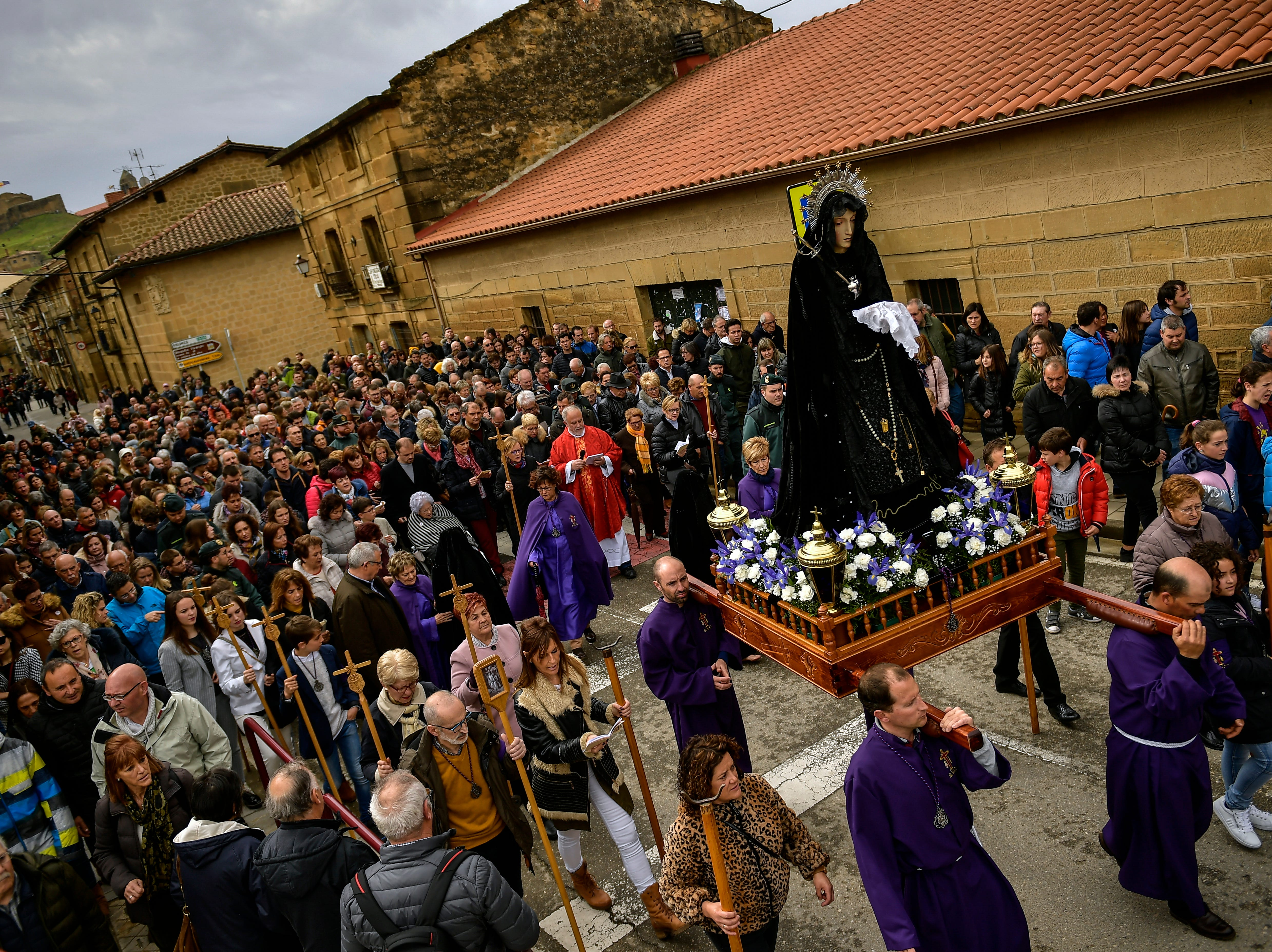 Devotees and penitents from the ''Santa Vera Cruz'' brotherhood known as ''Los Picaos'' take part in a Holy Week procession in San Vicente de La Sonsierra, northern Spain, Friday, April 19, 2019.
