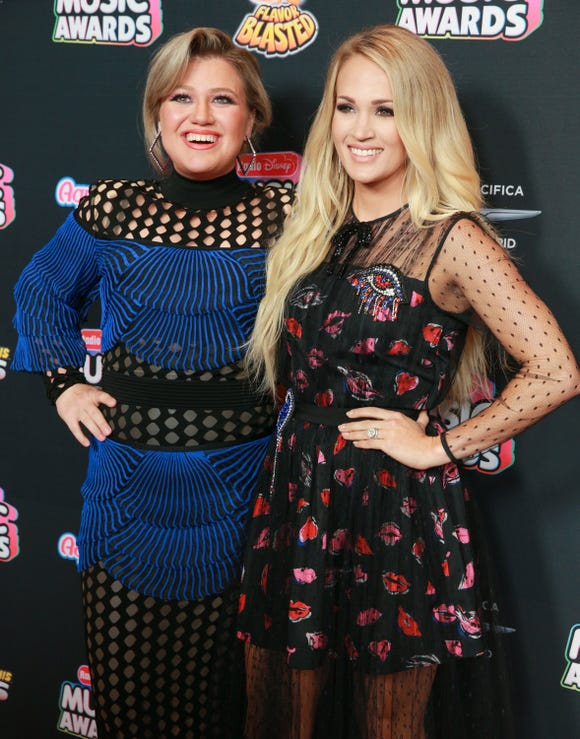 Feud? What feud? Kelly Clarkson and Carrie Underwood at the Radio Disney Music Awards on June 22, 2018, in Hollywood.