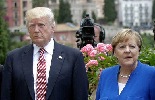 President Trump was flanked by German Chancellor Angela Merkel on 26 May 2017 during the G7 meeting in Taormina (Italy).