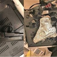A handgun concealed inside a DVD player.