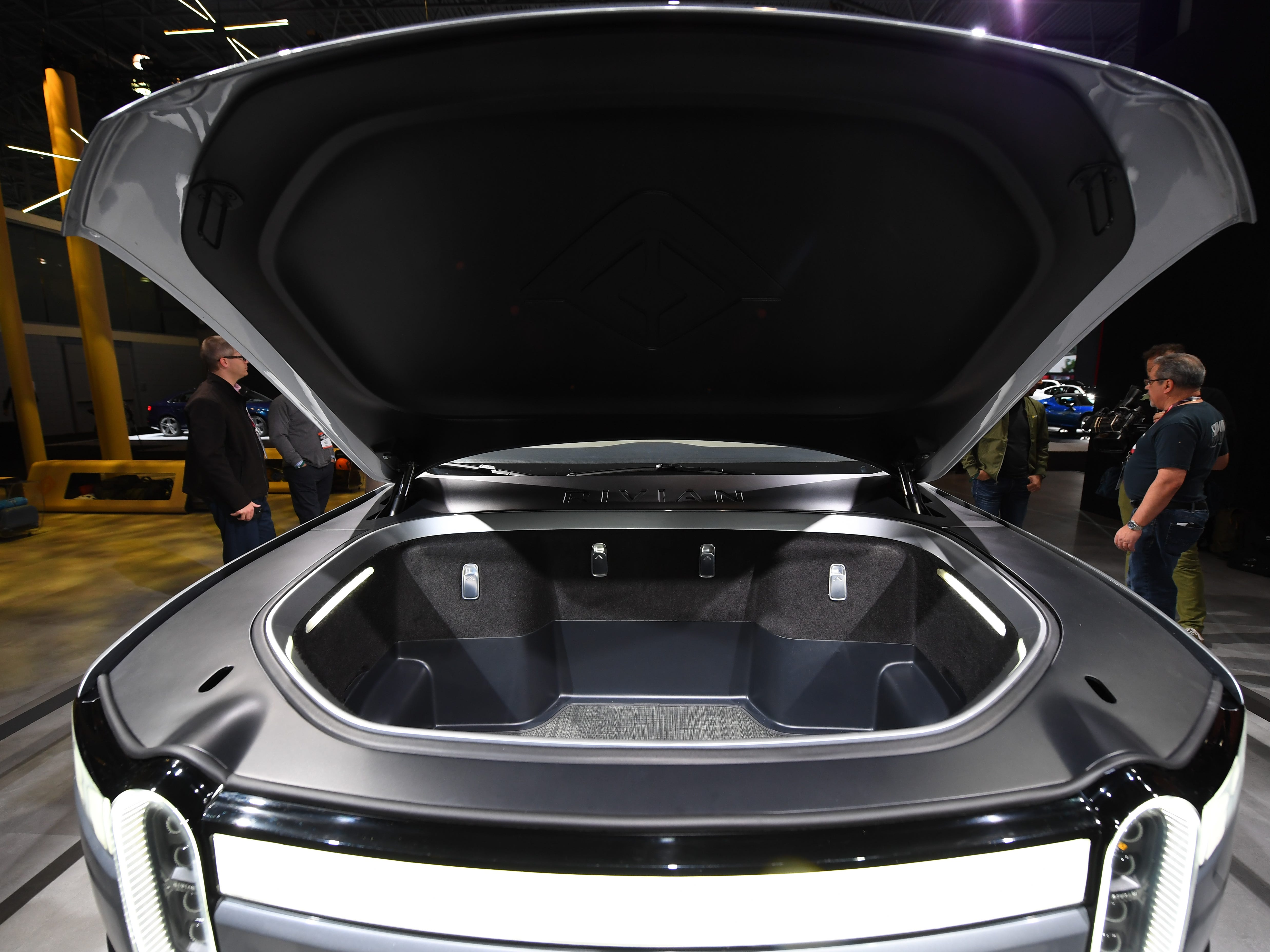 """The Rivian RT1 electric truck has storage where an engine used to be, otherwise known as a """"frunk."""""""