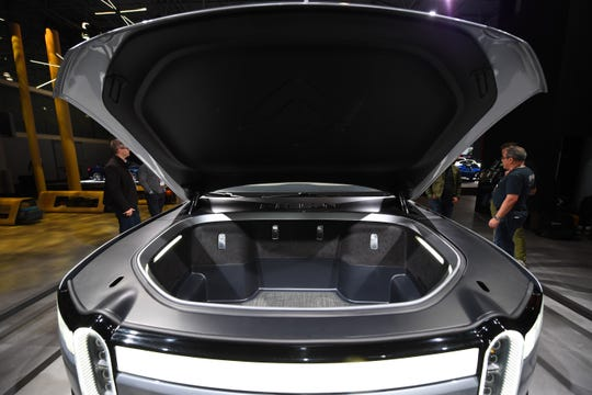 "The Rivian RT1 electric truck has storage where an engine used to be, otherwise known as a ""frunk."""