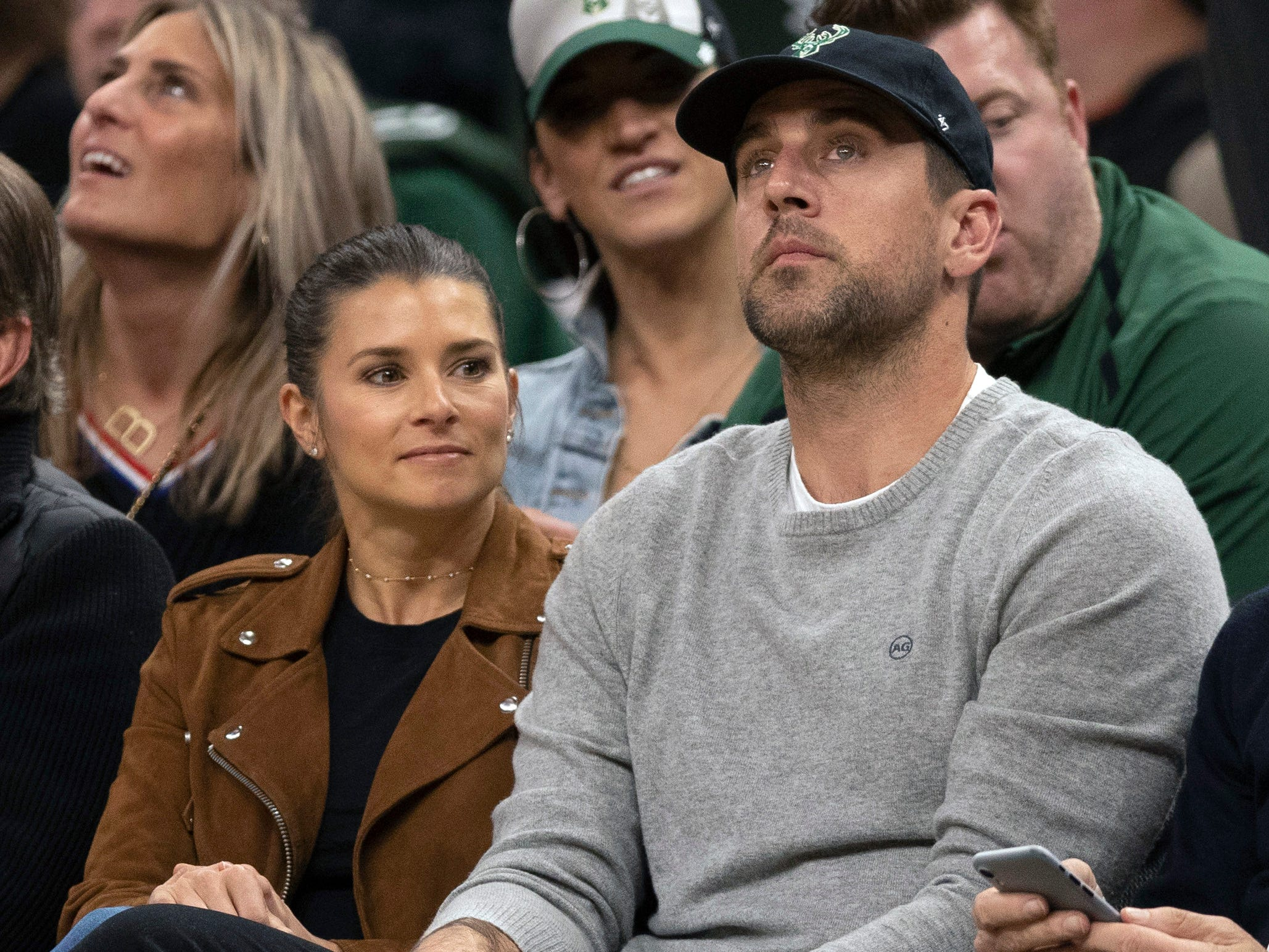 April 17: Danica Patrick and Aaron Rodgers look on during the fourth quarter of Game 2 between the Pistons and Bucks in Milwaukee.