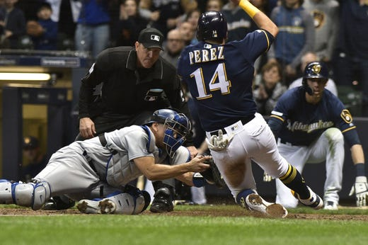 April 18: The Milwaukee Brewers' Hernan Perez (14) is tagged out at home plate by Los Angeles Dodgers catcher Austin Barnes in the eighth inning at Miller Park. The Dodgers won the game, 3-1.