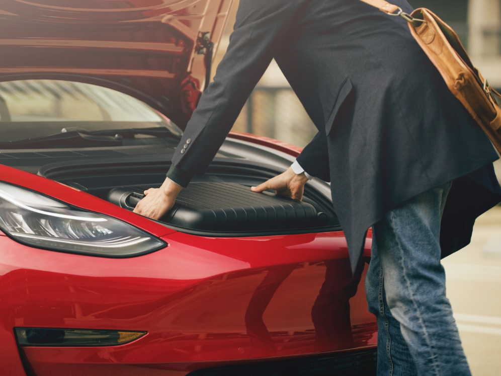 """The Tesla Model 3 comes with storage space under its hood, otherwise known as a """"frunk."""""""