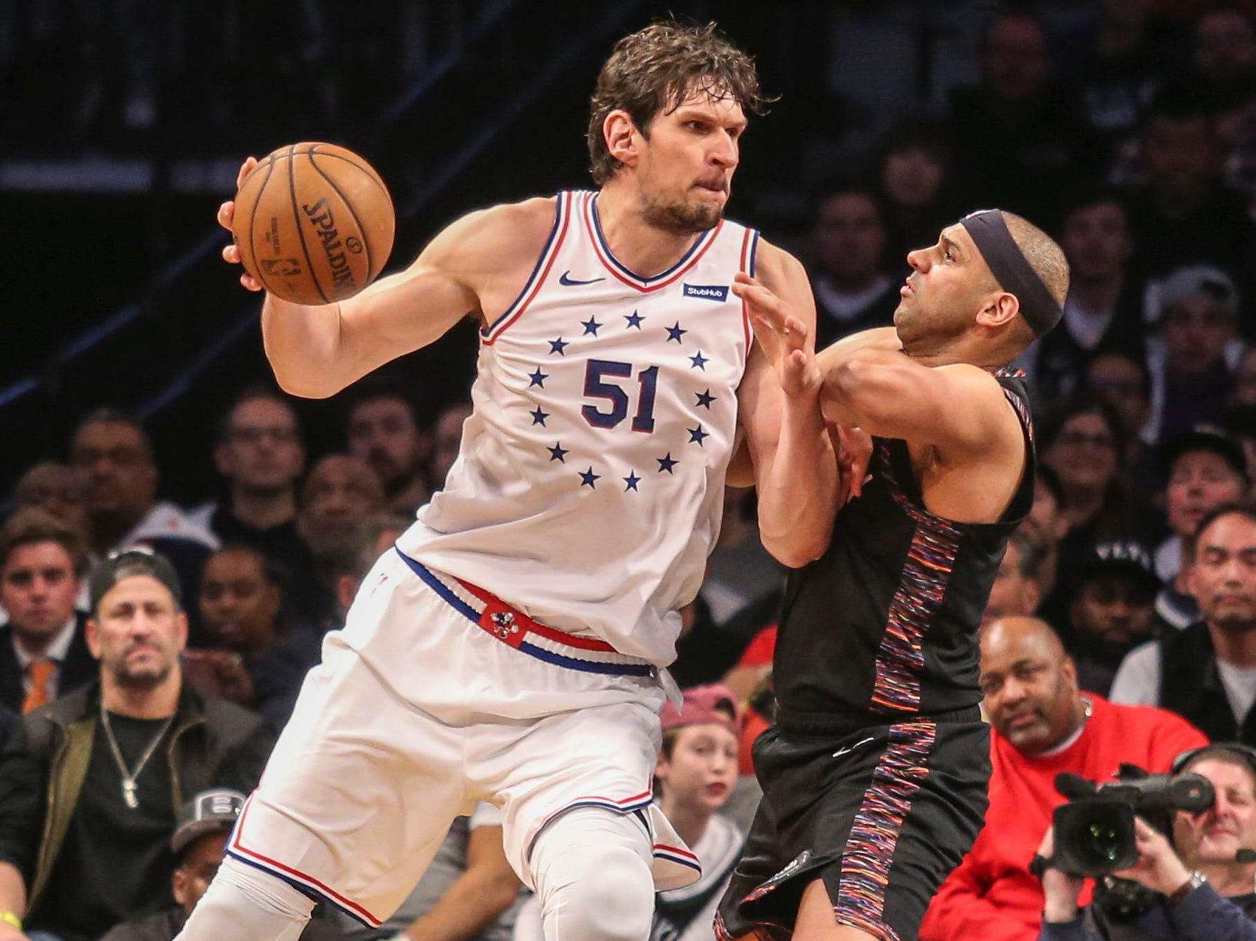 April 18: Nets forward Jared Dudley (6) tries to hold his ground against 76ers center Boban Marjanovic (51) during Game 4.