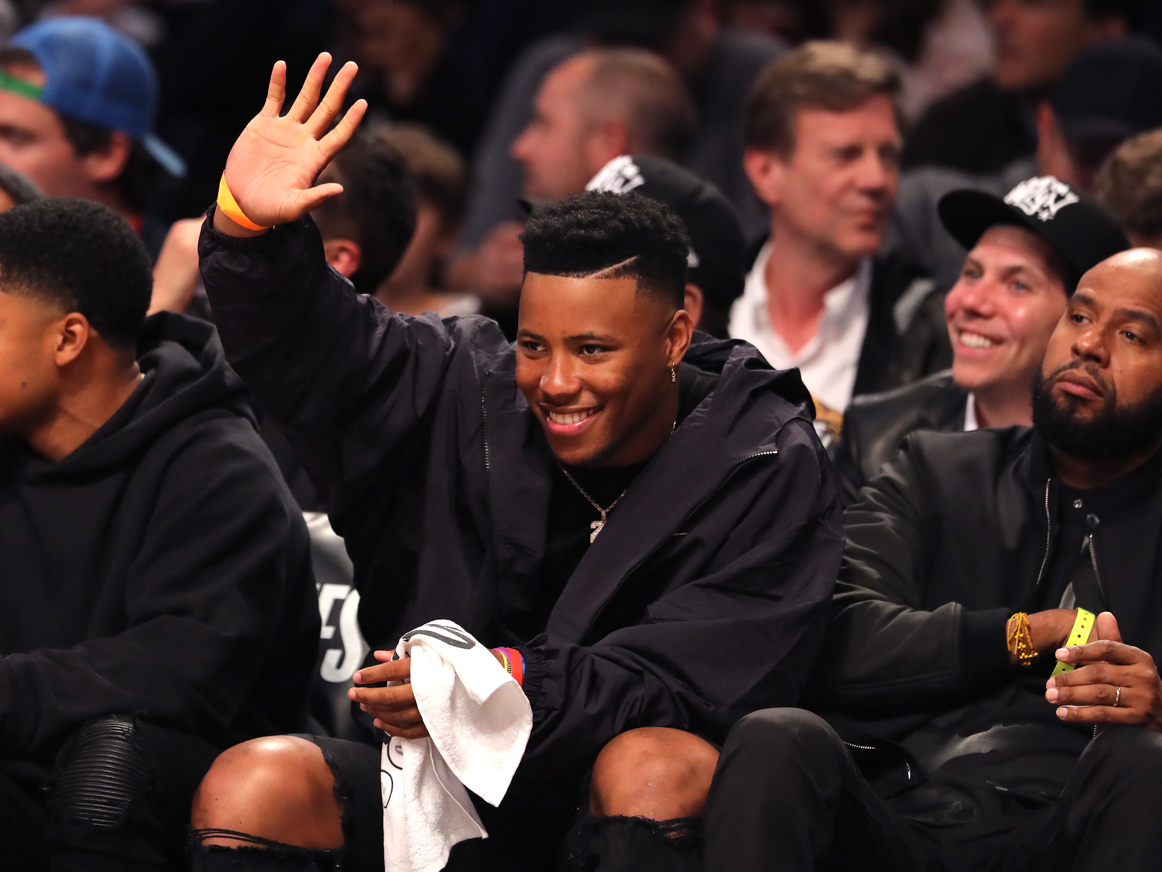 April 18: Saquon Barkley of the New York Giants attends Game 3 between the Nets and 76ers in Brooklyn.