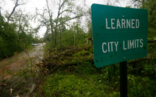 Fallen trees line the roads leading into the small community of Learned, Mississippi, on April 18, 2019. Several homes were damaged by fallen trees in the tree lined community.